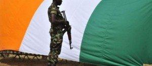 Révolution Permanente/Libération de la Côte d'Ivoire : Appel à une fraternité d'armes à l'attention des FDS ! dans La Révolution Permanente soldat-et-drapeau-ivoirien-300x131